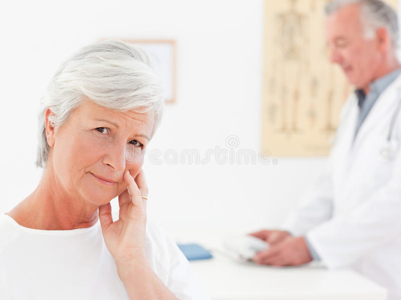 Sick patient with her doctor royalty free stock image
