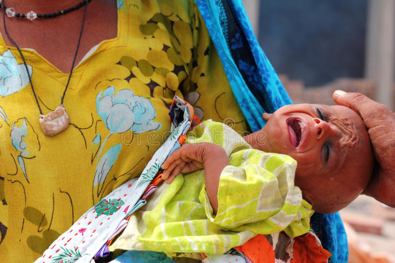 Download Sick Refugee Baby Crying editorial photography. Image of flood - 21080947