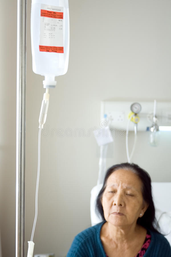 Sick senior infusion at hospital stock photo