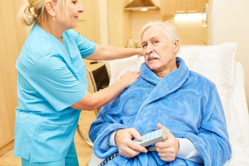 Sick senior man in nursing bed royalty free stock image