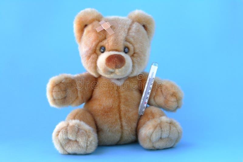 Sick teddy bear royalty free stock photography