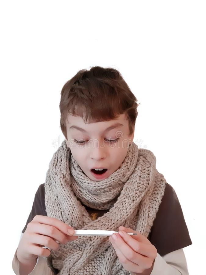 Sick teen in grey knitted scarf with thermometer on hands isolated on white background. stock photo