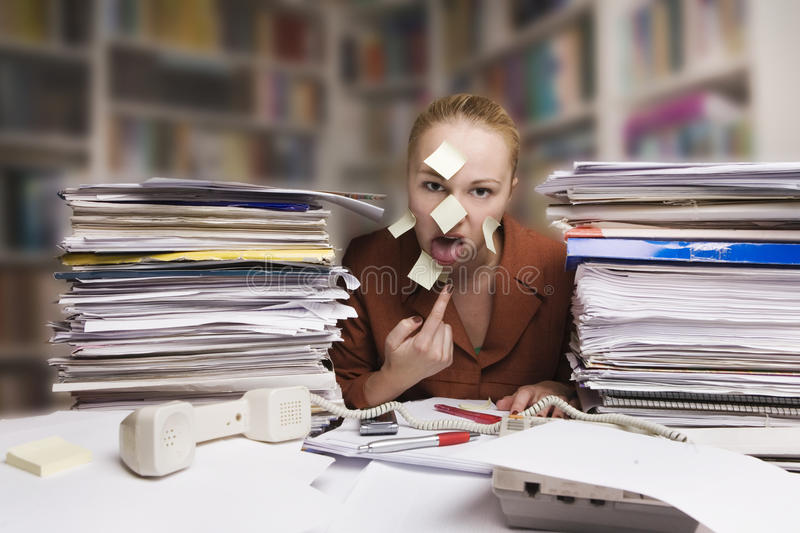 Sick and tired businesswoman at the desk stock photos