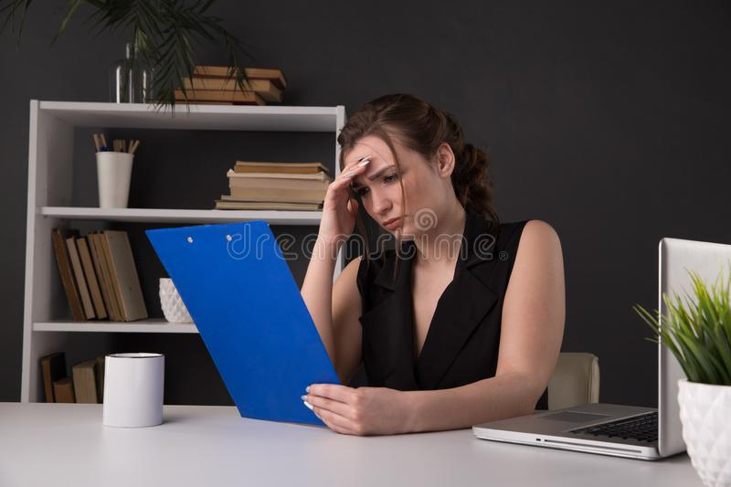Sick and tired office woman at her workplace. Headache concept. royalty free stock photos