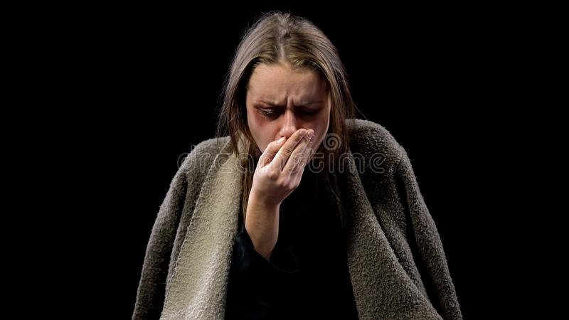 Sick woman coughing into hand, suffering contagious disease, tuberculosis stock photography