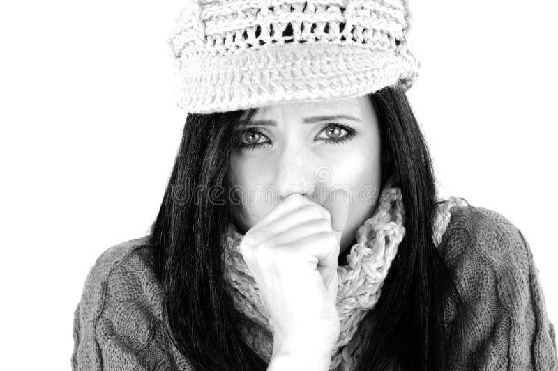 Sick woman coughing isolated feeling sick in winter. Beautiful woman with hat and scarf feeling fever royalty free stock photo