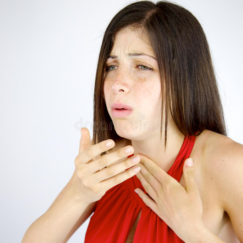 Sick woman coughing isolated. Unhappy woman feeling sick with coughs royalty free stock images