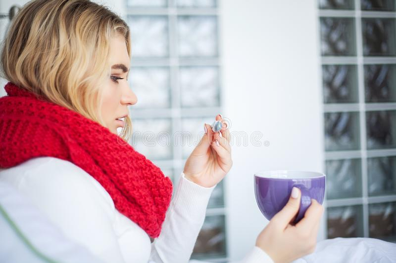 Sick woman with flu. Woman Suffering From Cold Lying In Bed With. Tissue stock photo