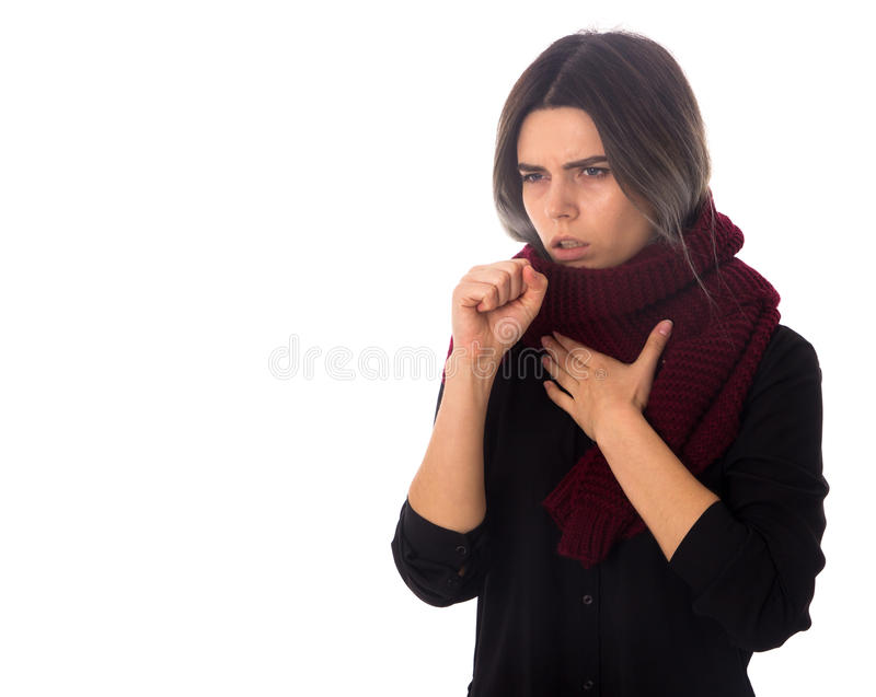 Sick woman with scarf coughing. Young sick woman with dark hair in black blouse with vinous scarf cuoghing on white background in studio stock photo