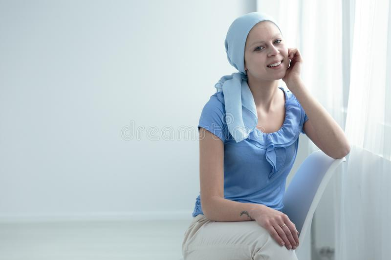 Sick woman smiling with hope royalty free stock photo