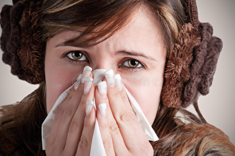 Sick Woman Sneezing royalty free stock images