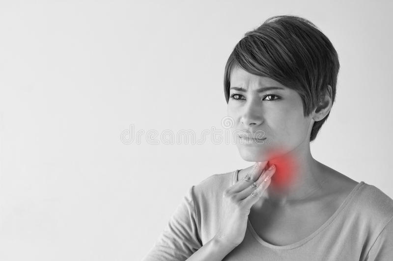 Sick woman with sore throat, inflammation royalty free stock photos