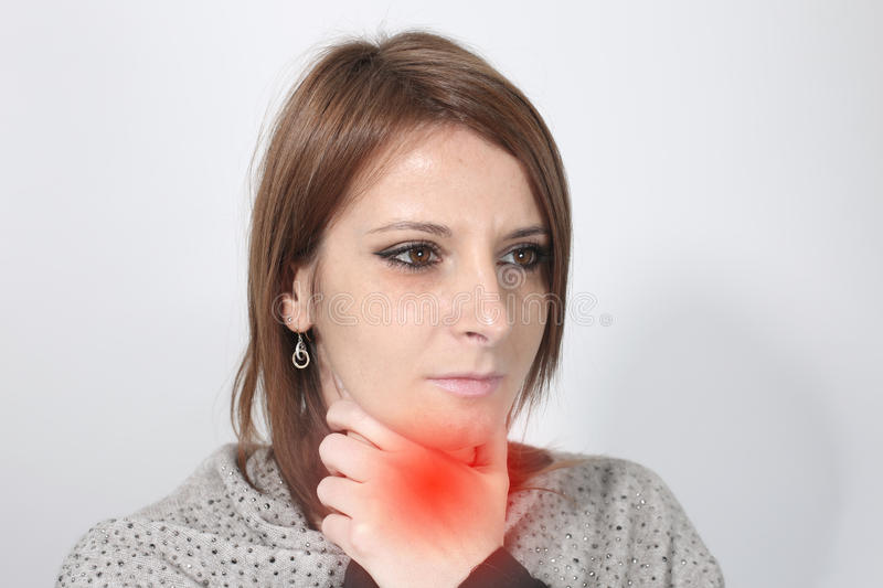 Sick woman suffering from sore throat. Over a white background royalty free stock photo