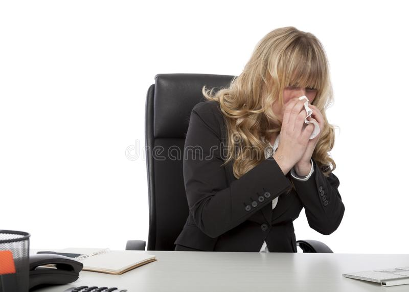 Sick young businesswoman at work stock photos