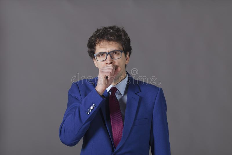 Sick young man in blue suit stock photography