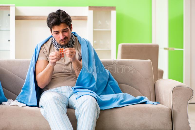 The sick young man suffering from flu at home. Sick young man suffering from flu at home royalty free stock photos