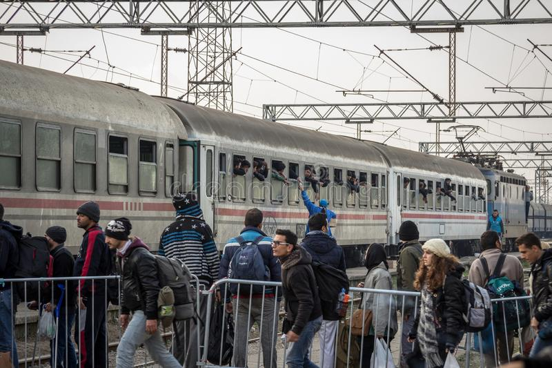 Groups of refugees boarding a train to cross the Croatia Serbia border, at the Sid train station on the Balkans Route. SID, SERBIA - NOVEMBER 14, 2015: ..Picture stock photos