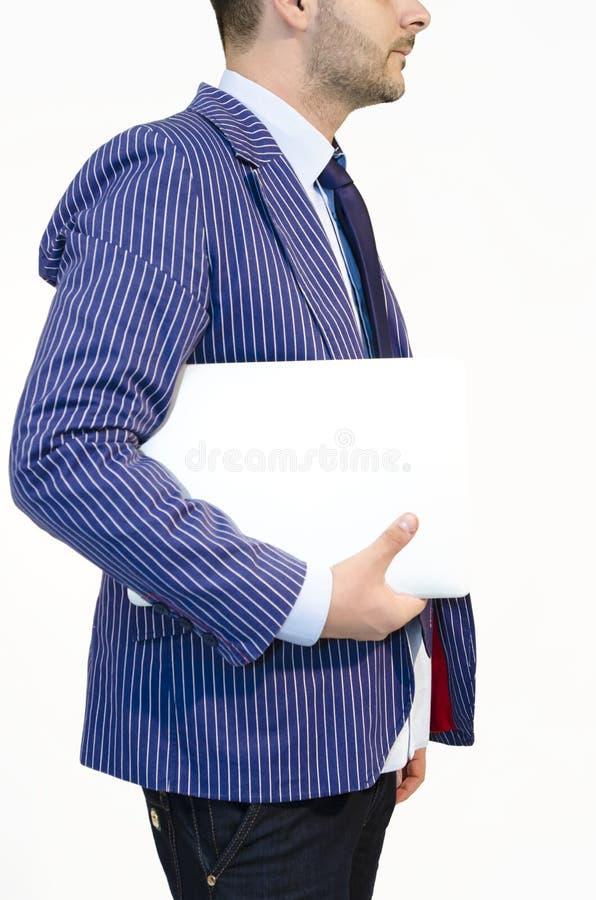 Sida av bärbara datorn för vit för winth för affärsman royaltyfria bilder