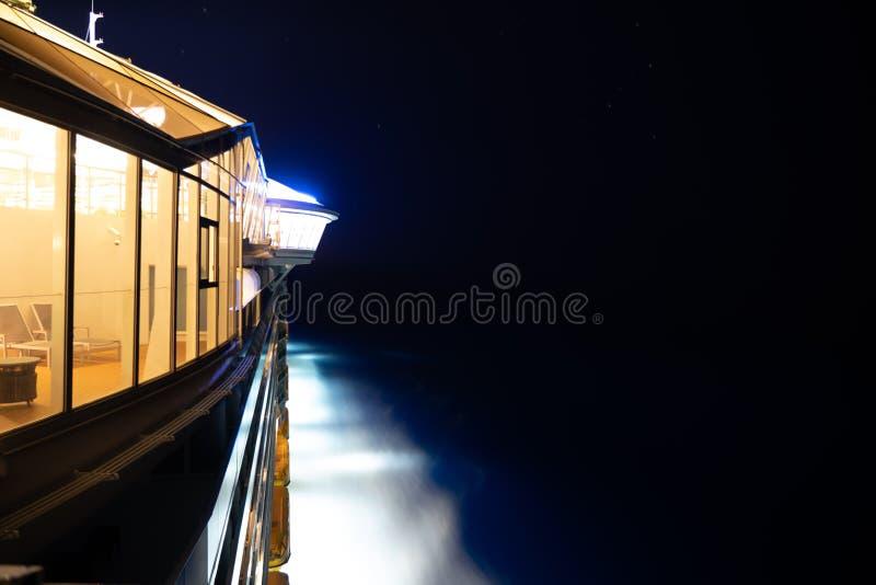 Sida av kryssningskeppet på natten royaltyfria foton