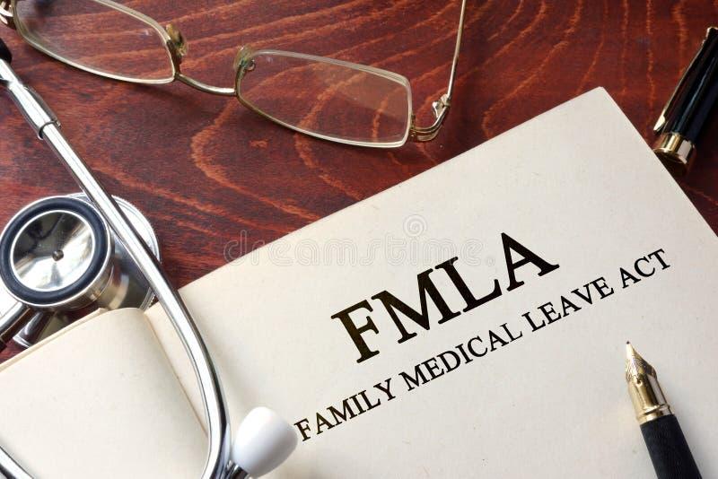 Sida med handling för tjänstledigheter för FMLA-familj medicinsk arkivbild