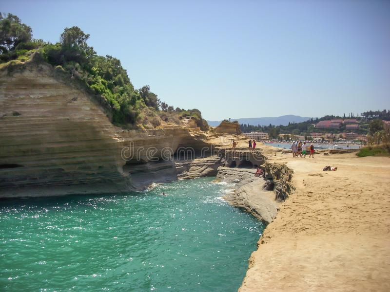 Sidari, Corfu, Greece - June 08 2013 : Tourists having fun at Canal d`amour on Corfu - Kerkyra island - Sidari beach.  stock image
