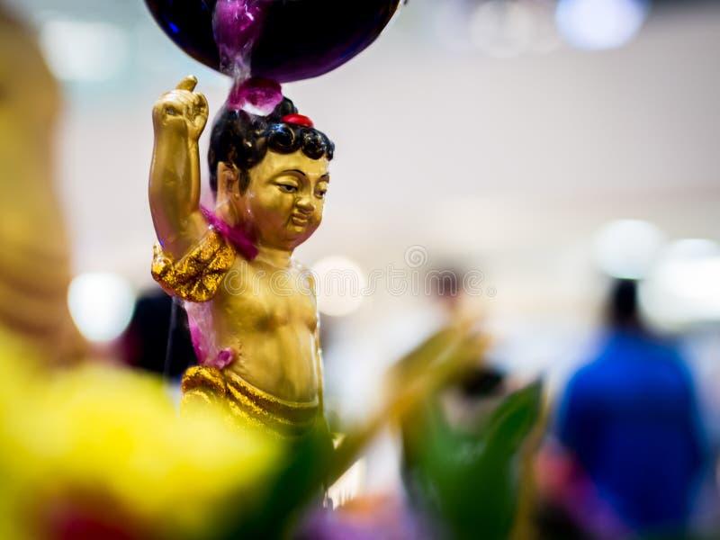 Siddhartha Gautama Buddha Sculpture Flushed by Water and Flower.  stock photos
