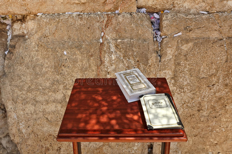 Siddur and Book of Psalms at Western Wall in Jerusalem. Siddur and Book of Psalms on small wooden table at Western Wall (aka Wailing Wall) in Jerusalem, Israel stock image