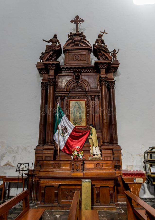Side altar in the Cathedral of San Gervasio in Valladolid, Mexico stock images