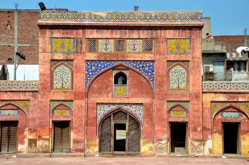 Side arch with kashikari frescoes and tiles Wazir Khan mosque Lahore Pakistan royalty free stock image