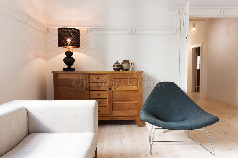 Side board buffet chair and lamp in a luxury apartment renovation stock image