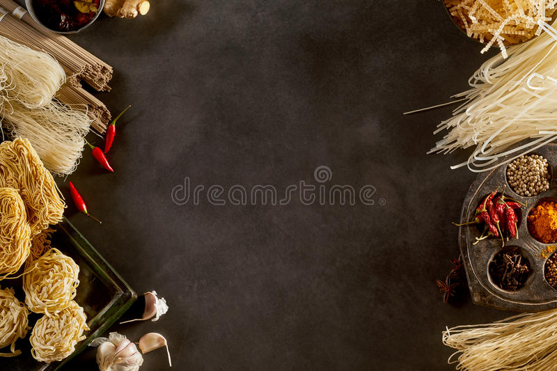 Side borders of dried Asian noodles and spices royalty free stock image