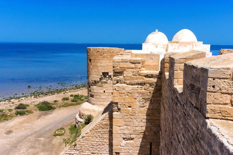 Side of the Borj el Kebir Castle with Mediterranean Sea in Houmt El Souk in Djerba, Tunisia. Tower of the Borj el Kebir Castle with background of Mediterranean stock photography