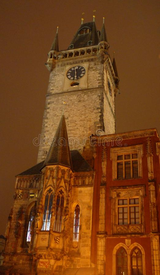 The side of a church tower in Prague in Czech Republic. Photo taken at night Prague in the Czech Republic. In the picture you see the upper part of the side, in royalty free stock photo