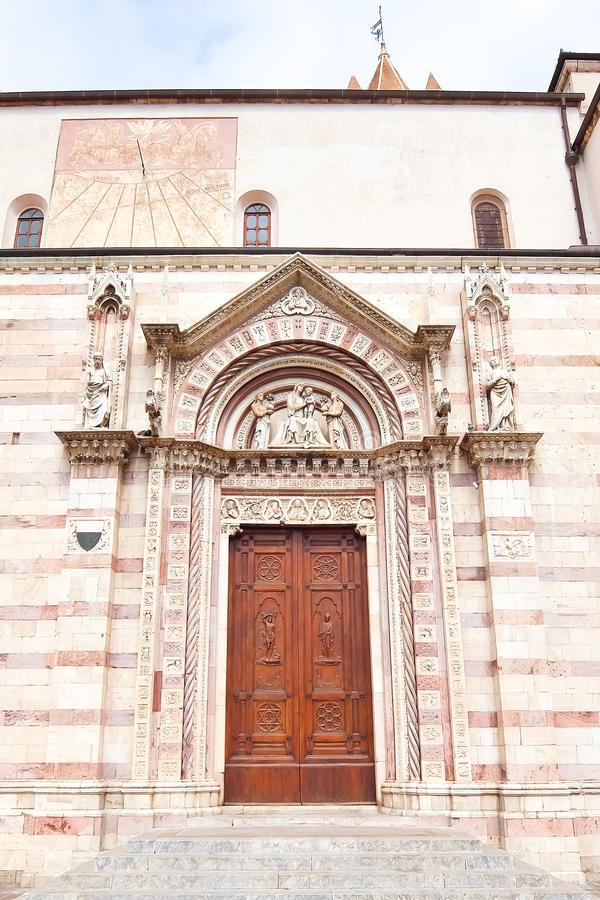 Side door of the cathedral of Grosseto in Italy. Duomo di Grosseto - San Lorenzo nella Cattedrale. XIII century stock photography
