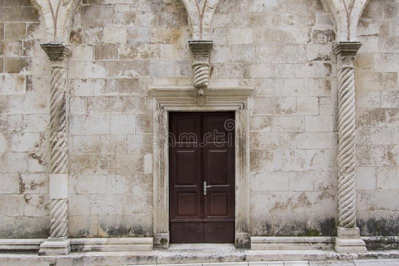 Side door of the St. Chrysogonus church in Zadar, Croatia stock photos