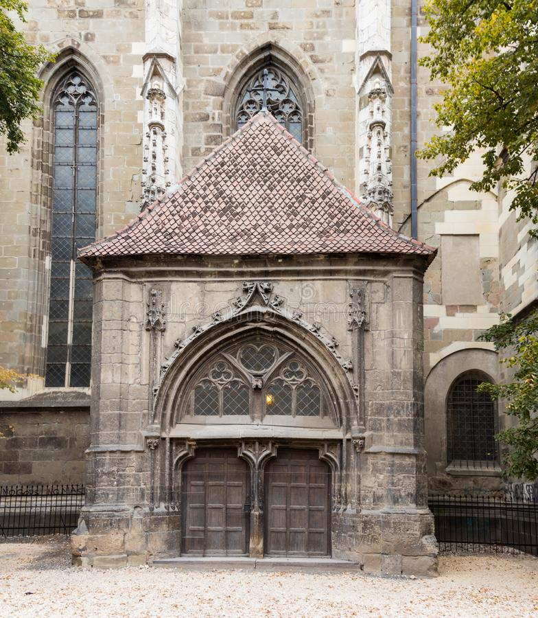 Side entrance to the Black Church, built in the Gothic style and named after the dark color left after the fire of the 17th centur. Y in the Brasov city in royalty free stock photography