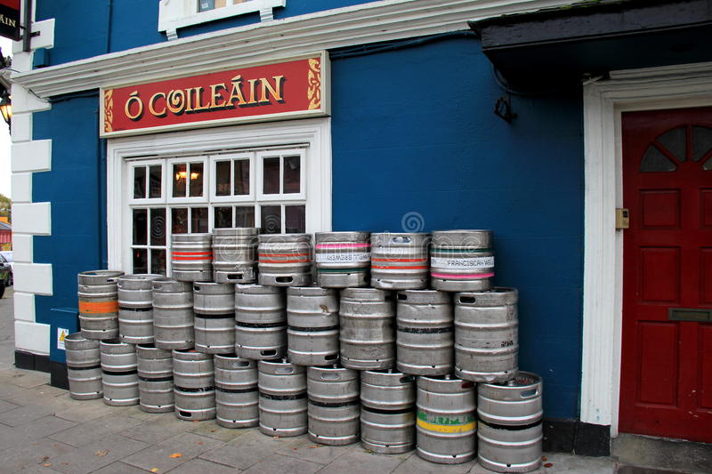 Side entrance to the famous Pat Collin's beer pub,with colorful beer kegs right outside,Adare,Ireland,October,2014. Side entrance to the famous and popular Pat stock image