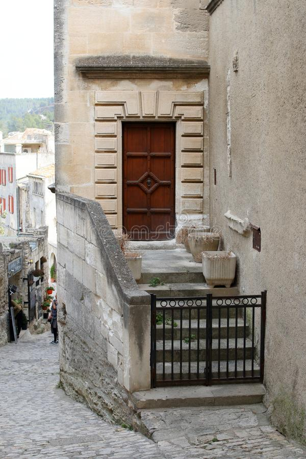 The side entrance with wooden door and stone stairs royalty free stock images
