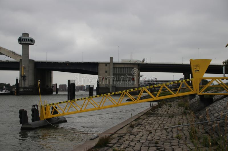 Side of the entry to the water taxi in Rotterdam at the van Brienenoordbrug bridge royalty free stock photo