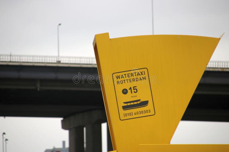 Side of the entry to the water taxi in Rotterdam at the van Brienenoordbrug bridge royalty free stock image