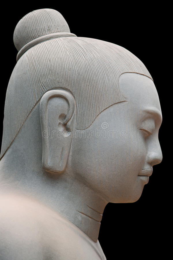 Side face of Buddha statue royalty free stock image