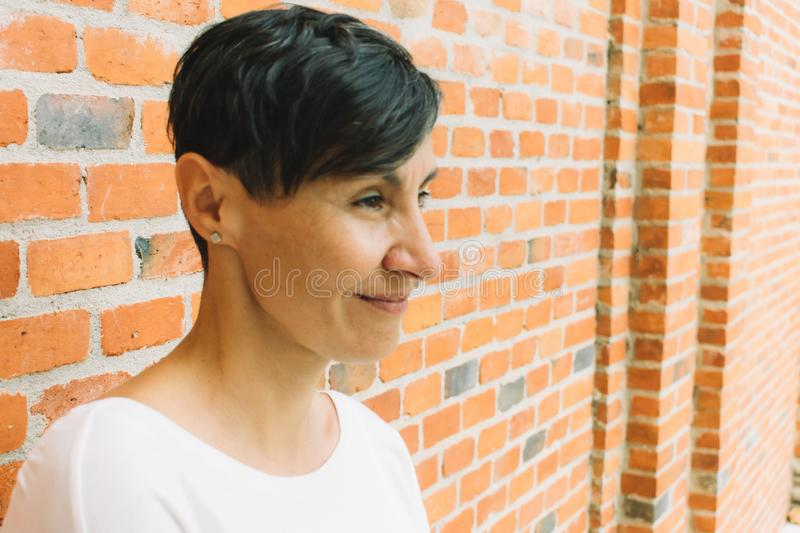 Side face of middle-aged woman short black hair. A side face of middle-aged woman short black hair royalty free stock image
