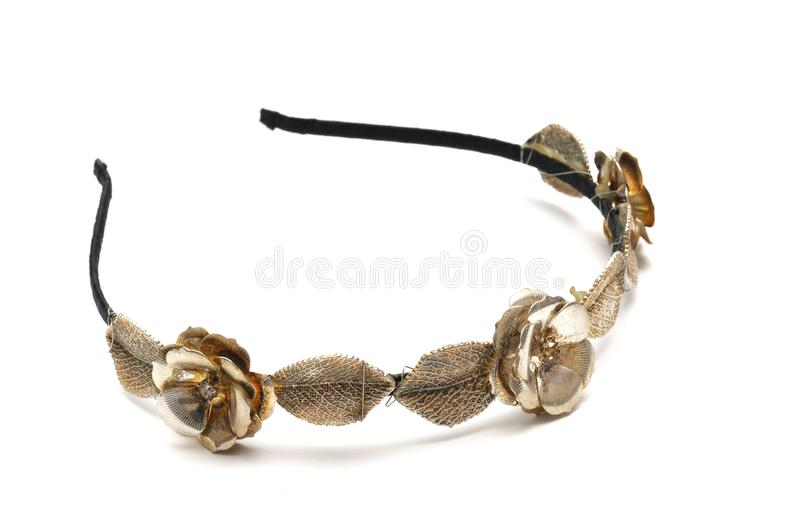 A hairband with metal flowers and leaves decoration stock photography