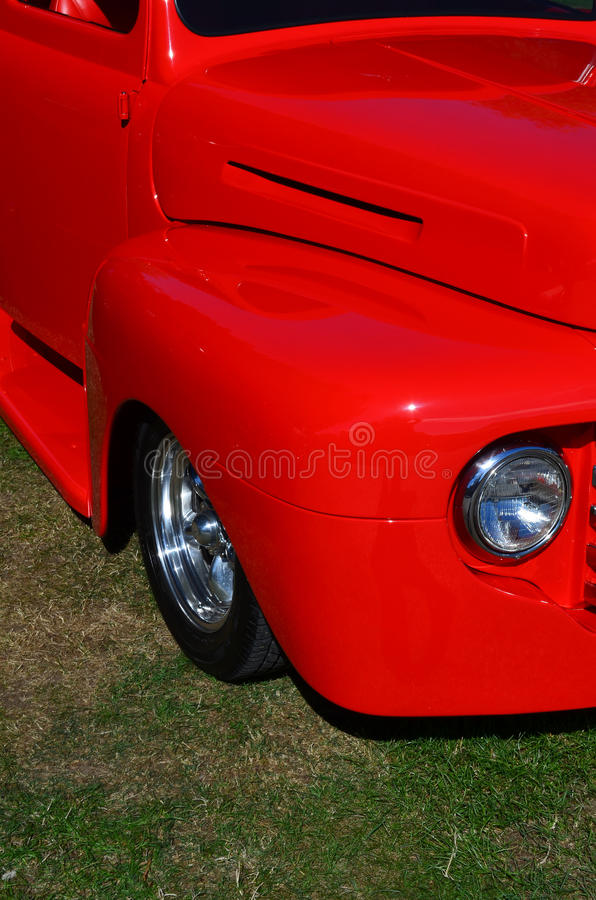Side fender on a hot rod. Side view of a red lowered hot rod stock images