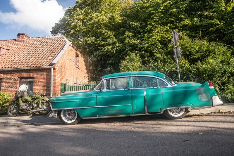 Side front view old classic green Cadillac parked royalty free stock image
