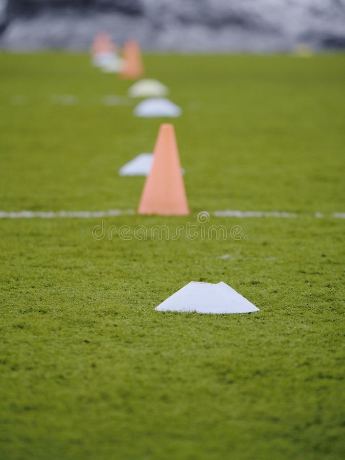 Side line of an outdoor football training field. Side line of an outdoor football soccer training field white trainer sunny sport skills school professional royalty free stock images