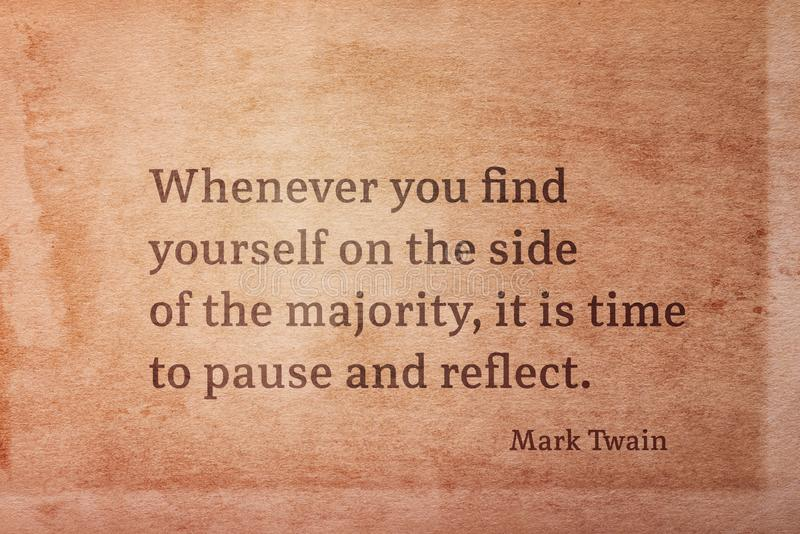Side of majority Twain. Whenever you find yourself on the side of the majority - famous American writer Mark Twain quote printed on vintage grunge paper royalty free illustration