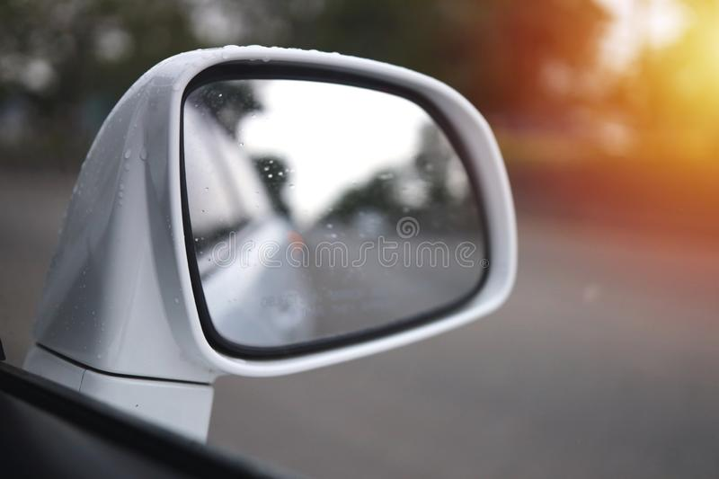 Side mirror of one car Reflecting the road and the tree view beside royalty free stock images
