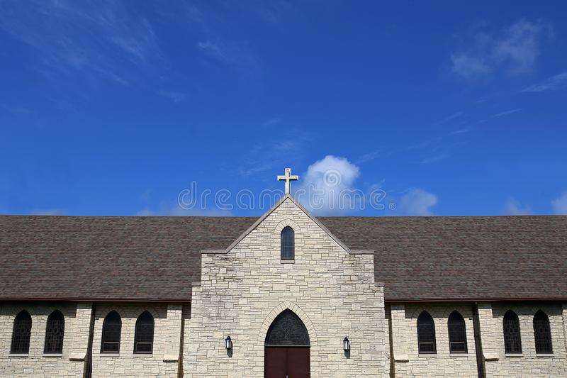 Stained Glass Windows and Cross on Church Steeple of Old Christi stock photos