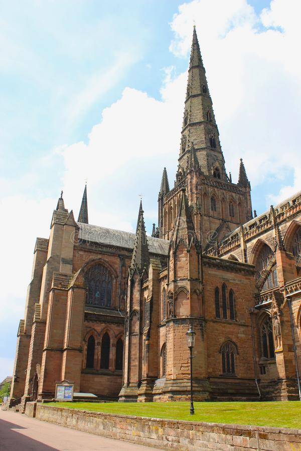 Side shot of Lichfield Cathedral in Staffordshire, England. The side and one of the spires of the historic Lichfield Cathedral in Staffordshire, England stock photos